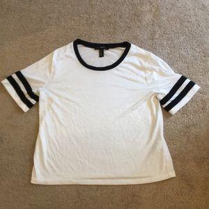 white and black short sleeve shirt